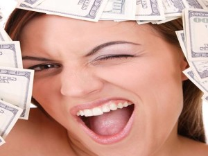 Pretty lady holding cash