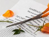 Scissors cutting marriage certificate
