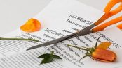 Scissors cutting marriage certificate